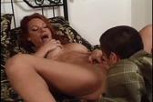 Redhead slut rides a midg...