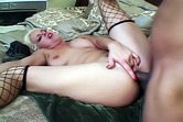Blond whore in stockings takes big black dick