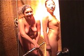 A pair of hot teen chicks wash off together, shave in the shower