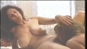 Vintage lesbians admire bodies in the mirror before eating pussy in bed