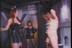 Dominatrix in leather with big titties squeezes a guys balls
