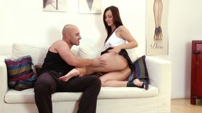 Blazing brunette gives a stiff cock a foot fuck before taking it up her asshole
