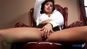Hot brunette strips then masturbates in office chair