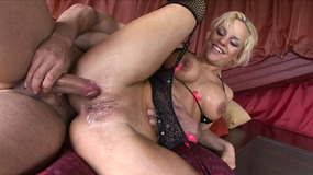 hot blonde milf sucks on two thick cocks.