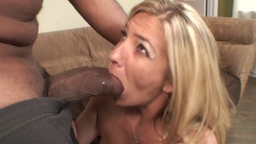 Sexy blonde whore rubs her pussy while taking hard black cock up her tight twat