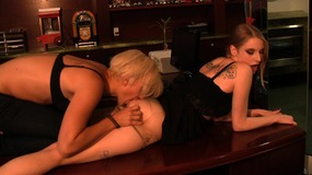 Horny lesbian couple pleasure each other on a desk