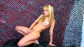 Young blonde with small tits poses naked and fingers her pussy