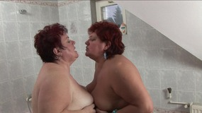 Fatty lesbian whores enjoy sticking champagne bottle in each others pussy