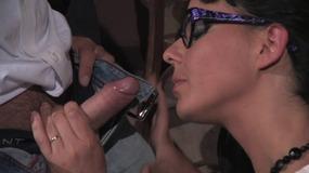 Geeky brunette sucks guy's cock on her knees at work
