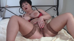 Horny mature with big boobs masturbating with a dildo till orgasm